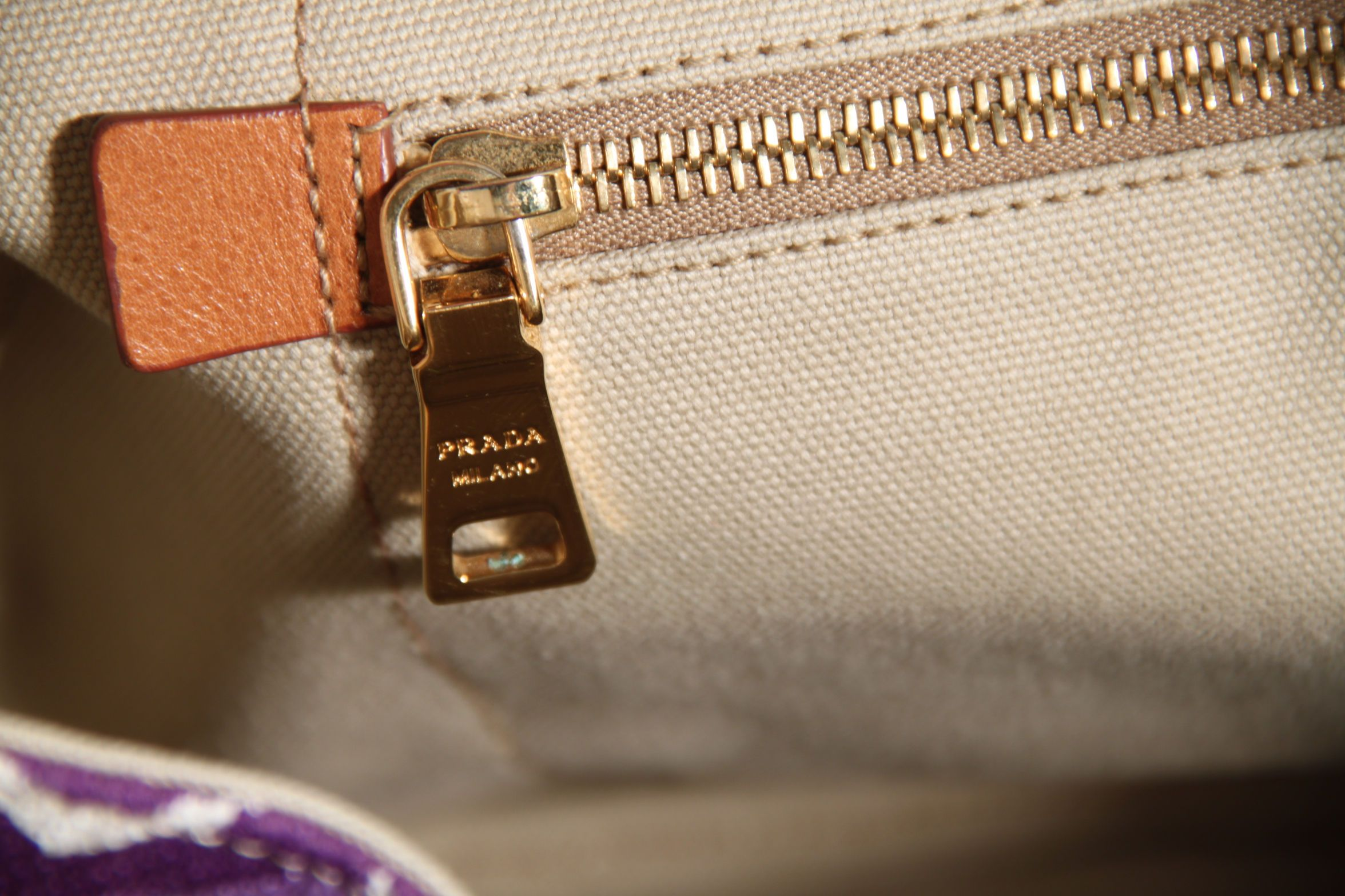 22c6ff15530992 Prada bags and most accessories have one or more of the below zippers: